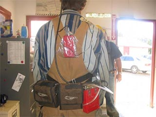 Air sampling equipment on person's back